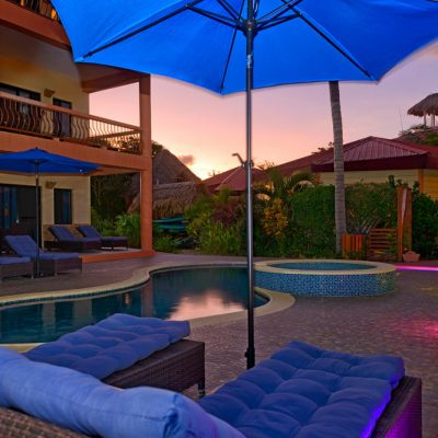 Pool umbrella at sunset