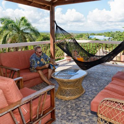 Reading a book on Belize rooftop