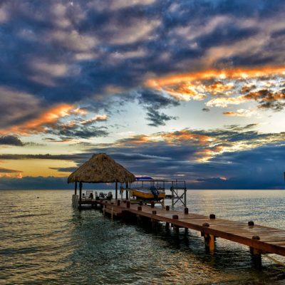 Palapa and dock at sunset