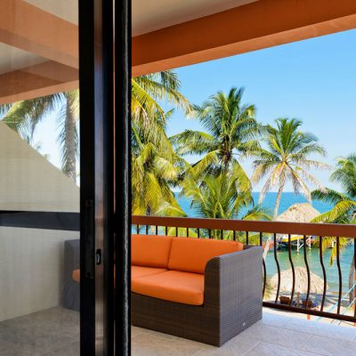 couch on balcony overlooking Caribbean
