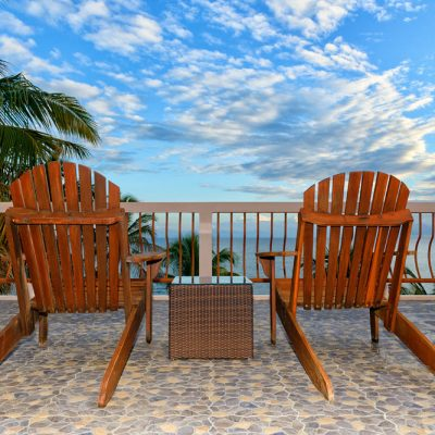 Two Adirondack chairs on Belize rooftop