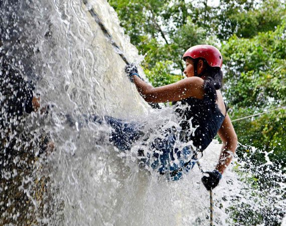 Belize waterfall rappelling